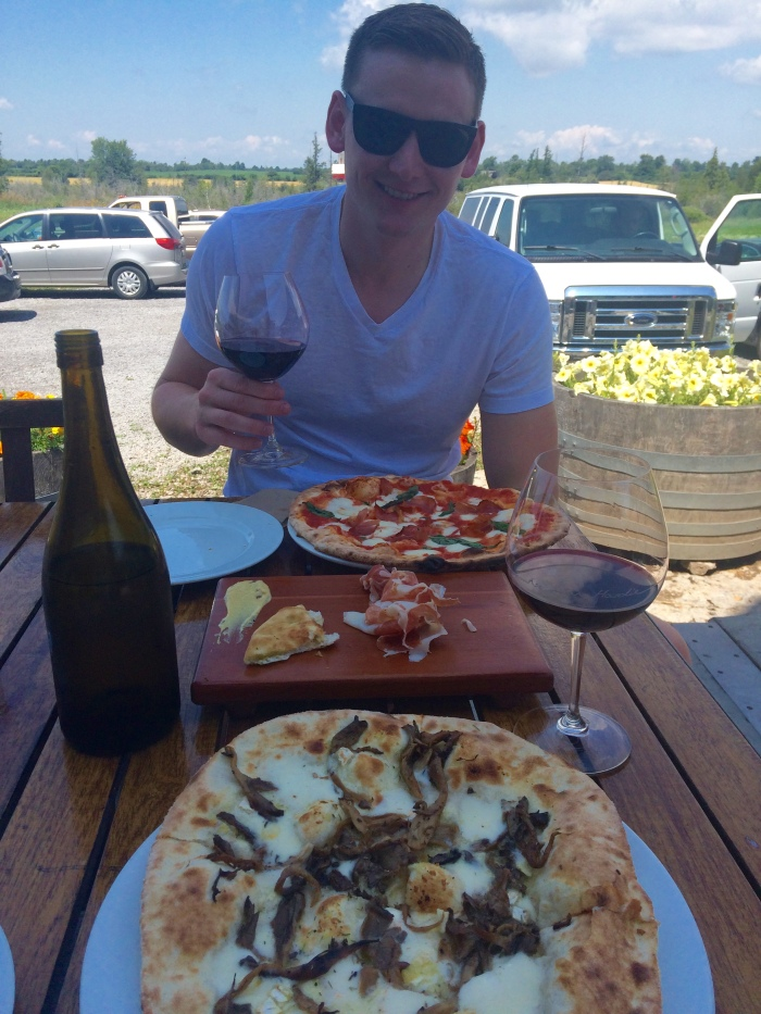 Wine, prosciutto and wood-fire pizza at the Norman Hardie winery.